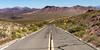 Death Valley 146 (Tasmanian58) Tags: california deathvalley usa desert road macadam nature sony a7ii loxia zeiss sky grass rock