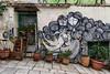 Athens street-art (Adrià Páez) Tags: athens streetart street art calle atenas greece grecia hellas ellada plaka plants plantas house casa door puerta balkans balcanes europa europe chairs sillas arte urbano canon eos 7d mark ii