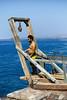 Local Fisherman Looks Over Cliff Edge (wyojones) Tags: hawaii hoist halaeacurrent kalae southpoint fishing fisherman hawaiian cliffs lookover pacific ocean water down