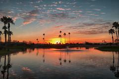Sun Lakes Sunset in AZ (jbarc in BC) Tags: arizona sunset sun palms oakwood sunlakes winter clouds sky water chandler az