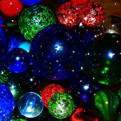 marbles close up 1 (ali j5) Tags: marbles spheres vividcolours colours closeup macro patterns lighting tones popart