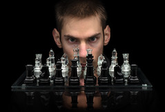 Chess Master (Wizards of Amazon) Tags: chess master person man face head eyes stare smart intelligent war leader mastermind intj strategy chessboard game isolated black reflection clear glass background copyspace king board transparent play knight pawn white bishop set competition power leisure win piece success teamwork object image army modern intelligence pieces perspective detail opponent unitedstatesofamerica