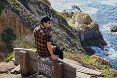 (thedankandthedark) Tags: mirrorlesscamera sonya6000 sonyalphaa6000 sony bench cliff rocks water ocean beach hwy1 highway1 pacificcoasthighway pacificcoast california bigsurcalifornia bigsur portraitphotography pose portrait malemodel model male guy