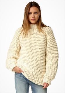 Sexy girlfriend in heavy knitwear outfit