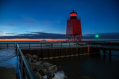 Guarding into the Night (T P Mann Photography) Tags: seascape sea pier railing blue ice evening longexposure dusk night lighthouse lights lake michigan charlevoix
