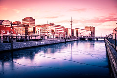 Icy city (Maria Eklind) Tags: is winter nature himmel spegling sweden outdoor canal malmö building pink architecture kanal sky sunlight reflection europe city ice skånelän sverige se