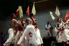 55-598 (ndpa / s. lundeen, archivist) Tags: nick dewolf nickdewolf photographbynickdewolf 1974 1970s color reel55 55 35mm film boston mass massachusetts symphonyhall stage performance catellitrinidadallstars trindadian ambakaila trinidadcarnivalballetandsteelband trinidad carnival ballet steelband dance dancing dancer dancers costume costumes costumed traditional performer performers show caribbean flag flags headband headbands women youngwomen dress dresses whitedress whitedresses headwrap headwraps men youngmen shirtless sash redsash woman youngwoman