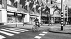 Cyclist at crossroads Rotterdam Holland. (James- Burke) Tags: cubehouses streetcyclist netherlands graphic street pandacrossing angular trafficlights holland rotterdam man angles pedestriancrossing contrasts lighting candid roadjunction