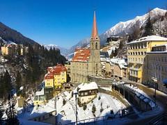 Bad Gastein, Austria, in winter (echumachenco) Tags: road tower tree snow sky mountain building church valley badgastein gasteinertal alps spa iphone salzburg austria österreich