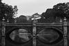 Nijubashi (tokyobogue) Tags: tokyo japan marunouchi nikon nikond7100 d7100 sigma sigma1750mmexdcoshsm blackandwhite blackwhite monochrome nijubashi imperialpalace palace bridge reflection tourist water moat