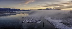 Pitt River Sunrise (Sworldguy) Tags: pirtriver portcoquitlam pittmeadows river water sunrise mist landscape morning logs mountains waterfront serene foggy logboom reflections snow frost nikon d7000 dslr