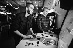 Nick & Jeff (BurlapZack) Tags: pentaxk1 pentaxfa20mmf28 vscofilm pack06 dallastx cidercade bishopciderco cidery arcade killerqueen videogame game bw mono monochrome gamer gaming portrait candid bokeh dof availablelight handheld lowlight wideangle concentration competition