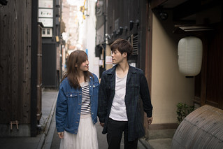 Young Japanese couple walking on alley in Ponto-Cho, Kyoto, Japan