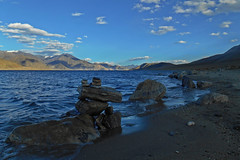 As the waves delivered the mountain's letters to the shore!!! (Abeer!) Tags: landscape pangong ladakh lake clouds sky himalaya himalayas highaltitude highaltitudelake abeer abeerbarman india mountain peak shore stone blue waves rock water