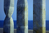 Trying to hide (Fnikos) Tags: sea seascape water sky skyline boat sailboat sculpture column architecture outdoor