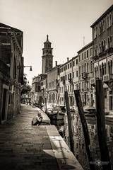 Alone in Venice (Michał Banach) Tags: italy venice wenecja alone architecture boat boats canal canale holiday man sepia trip water men outdoor outside tower campanile building buildings monochrome sonyslta77v sonydt1650mmf28ssm