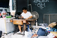 Bangkok Stitch Up (35mm) (jcbkk1956) Tags: street bangkok thailand thonglo film 35mm minolta x700 kodak kodakgold200 manualfocus tailoring analog man thai sewing 50mmf14 worldtrekker