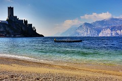Silhouette on the lake (giobertaskin) Tags: canon controluce cielo silhouette lagodigarda garda lago spiaggia scaligero castello malcesine