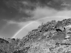 Rainbow in black & white (Carmen Cabrera .) Tags: iphoneography iphoneographer iphone iphoneart iphone6s blackandwhite bw rainbow blancoynegro arcoiris lluvioso lluvia rainy rain wet mojado lowangle clouds sky stones rocks infinitexposure