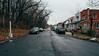 Down the Street (Juni Safont) Tags: newyorkcity nyc queens woodhaven street rain cloudy overcast rowhomes forestpark architecture straightaway