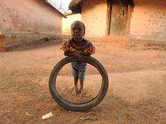 Bike Tire (Drew Makepeace) Tags: girl child guinea tire
