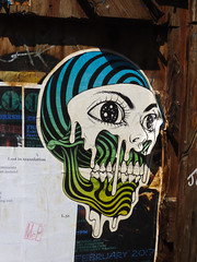 Lost in Translation (Steve Taylor (Photography)) Tags: lostintranslation february 2017 skull eye universe space dripping lady art graffiti pasteup wheatup wheatpaste streetart poster black blue green brown white scary creepy eerie frightening spooky weird strange woman uk gb england greatbritain unitedkingdom london face teeth