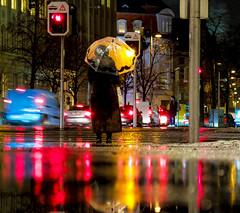 Protected (CoolMcFlash) Tags: night rain rainy person umbrella wet street streetphotography candid standing waiting vienna reflection light traffic city citylife fujifilm x30 nacht regen regenschirm nass strase stehen warten wien spiegelung asphalt stadt verkehr fotografie photography puddle pfütze