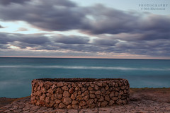 The Well and the Ocean (Oleh Khavroniuk (Khavronyuk)) Tags: nikon nikkor cuba varadero vacation travel atlantic ocean sky clouds windy longexposure nature naturaleza naturephotography contrast well ring streetphotography streetphoto street streetart art flickr new digital geotagged january 365 sunset beach beauty water sea seaview seascape blue light landscape dusk twilight timeless dawn eau long exposure