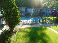 DSC00259 (classroomcamera) Tags: home apartment house tree shadow sun sunshine light sunlight pool swimming fence backyard court courtyard outside look view down below concrete path pathway