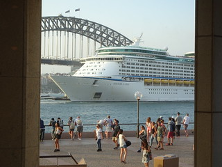 Sydney. Circular Quay. View from Matt Moran's Aria Restaurant. Cruise liner trying to turn around between Sydney Harbour Bridge and the Opera House.