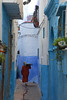 woman walking Larache Morocco_2572 (ichauvel) Tags: femme woman marcher walking rue street bleue blue larache maroc morocco afriquedunord northafrica voyage travel scénederue streetphotograhy photoderue exterieur outside jour day getty