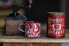 Old time coffee items - Anderson S.C. (DT's Photo Site - Anderson S.C.) Tags: canon 6d 135mml lens andersonsc vintage antique classic coffe tin cup grinder enamel red white bouquet brand table aged utensil hot roasted southern america usa southernlife collectible bokeh
