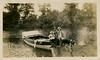 On The Kankakee River, June 1911 - Shelby, Indiana (Shook Photos) Tags: photograph photographs kankakeeriver thayerindiana shelbyindiana thayer shelby indiana lakecounty river waterway boat vessel couple child baby infant dog canine dock docking bucolic