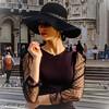 Sophisticated Lady (Gian Floridia) Tags: milano attitude black cappello city elegance fascino fashion hat misteriosa moda model nero pensierosa portrait street streetphotography urban week
