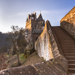 Stairs to Castle Eltz (redfurwolf) Tags: castle eltz rheinlandpfalz germany sunrise sun stairs outdoor outdoors architecture medieval stone tree sky morning nature castleeltz burgeltz moselkern mosel redfurwolf sonyalpha sony a99ii sal2470f28za sonydeutschland travel