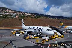 Finnair (Steenjep) Tags: madeira portugal ferie holiday urlaub funchalairport airplane airfield runway truck landscape sky boeing 737