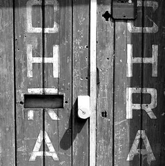 Letters on a doorway (Tony Worrall) Tags: outside outdoors caught photo shoot shot picture captured geometric abstract pattern texture symmetry minimalism diagonal surreal serene depthoffield england northern uk update place location north visit area county attraction open stream tour country welovethenorth nw northwest britain english british gb capture door doorway portal written words letters lock