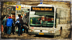 Boarding Now (myphotomailbox) Tags: rotterdam netherlands zuidplein busstation outdoor people sign road destination