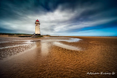 Talacre Lighthouse (Adrian Evans Photography) Tags: horizon rock rail window seashore water talacrelighthouse red wales beach maritime uk coastal sky disused lighthouse navigation landscape landmark architecture outdoor sand nautical clouds shore northwales british worn abandoned steps coastline tourism adrianevans sea talacre tower seascape pointofayre coast flintshire europe