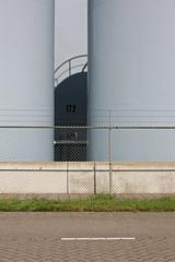 Behind the Scenes (lugarplaceplek) Tags: tanks 172 pernis fence