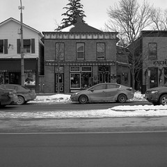 A Touch of Modern (.:Axle:.) Tags: niagaraonthelake ontario canada downtown urban town historic historicdowntown canadianhistory niagara newark winter snow offseason shawfestival hasselblad hasselblad500c slr 120 mediumformat 6x6 carlzeiss carlzeissplanar80mm128 ilford ilfordfp4 fp4 asa125 kodak kodakd76 d76 stock bw blackwhite gossenlunasixf epsonv700 adobephotoshopcc film filmphotography squareformat believeinfilm filmisalive filmisnotdead fp4party