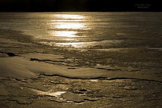 frozen river at golden sunset