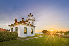 THE SUN LIT LIGHTHOUSE (LOURENḉO Photography) Tags: light house lighthouse sunset sun color art ocean sound waves ferry reflection ship marine orange blue view park glass puget pnw pacific north west pacificnorthwest winter spring summer historic lightkeeper keeper seattle mukilteo city fun play canon 5dsr ii day evening picture gallery washington