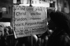 _MG_3245m (JetBlakInk) Tags: afro candid mono streetphotography nightphotography women streetpreacher signage christian crucifix cross lordjesus composition