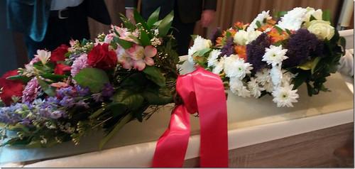 70mm fuchsia rouwlint met wit bedrukt