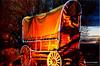 Covered wagon by the camp fire light. (jgbirdmangrossinger) Tags: yippeekiye coveredwagon camp fire light joegrossinger american west