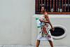 Woman Walking With Coffee Thermos, Cartagena Colombia (AdamCohn) Tags: kmtoin adamcohn cartagena colombia architecture colonial colonialarchitecture geo:lat=10426759 geo:lon=75549527 geotagged street streets wwwadamcohncom bolívar