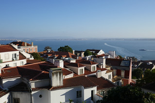 The Tagus River beyond red roofs of Lisbon