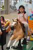 Out for a ride (radargeek) Tags: okc oklahomacity mall outlet outletshoppes umbrella horse riding kid child girl disney frozen 2018 february