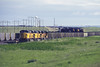 rr10442 (George Hamlin) Tags: wyoming bill railroad freight train unit coal union pacific powder river basin grass sky poles emd sd9043mac diesel locomotive southbound yard 8200 headlights photo decor george hamlin photography